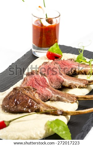 lamb ribs cooked on the grill served on a hot stone - stock photo