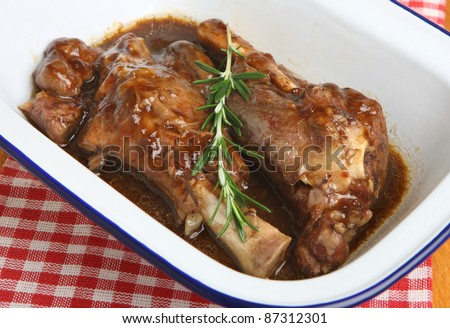 Lamb shanks cooked in a rich gravy - stock photo