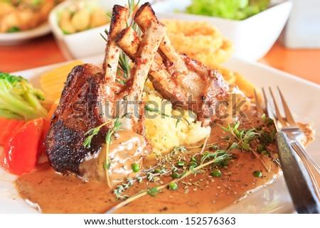 Lamb steak in white dish - stock photo