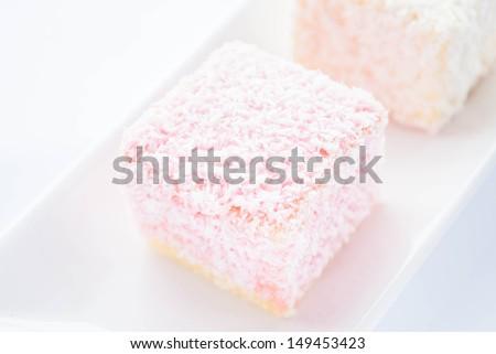 Lamington sponge cakes on the plate, stock photo - stock photo