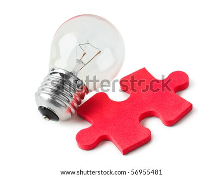 Lamp and red puzzle isolated on white background - stock photo