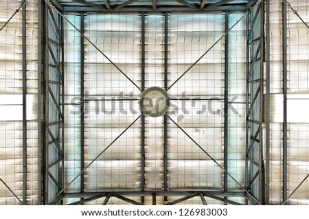 Lamp and Roof of large modern storehouse - stock photo