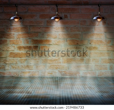 Lamp at brick wall background with glass floor - stock photo