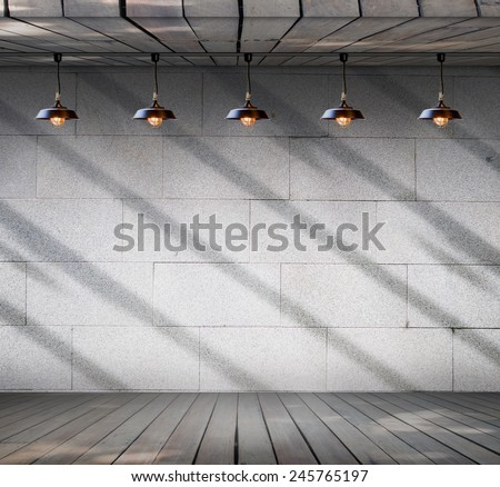 Lamp at Grungy concrete wall with wood floor, Template for product display - stock photo