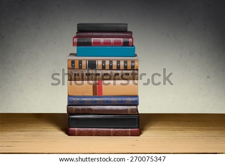 Lamp. Books on the table. No labels, blank spine. - stock photo