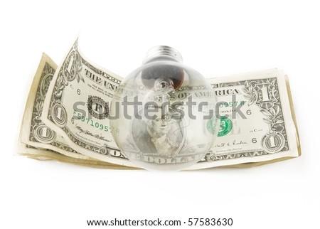 lamp bulb on american dollar background - stock photo
