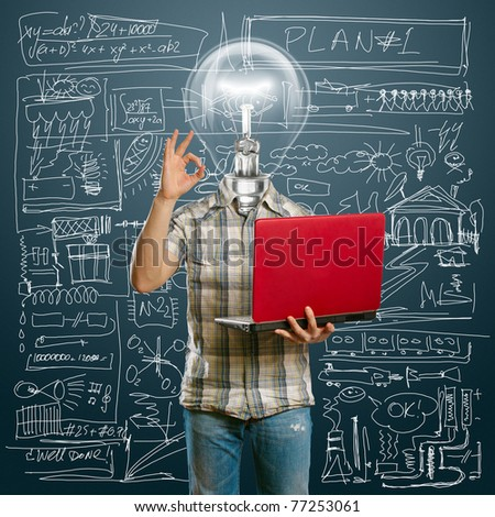 lamp-head male with laptop in his hands shows OK - stock photo