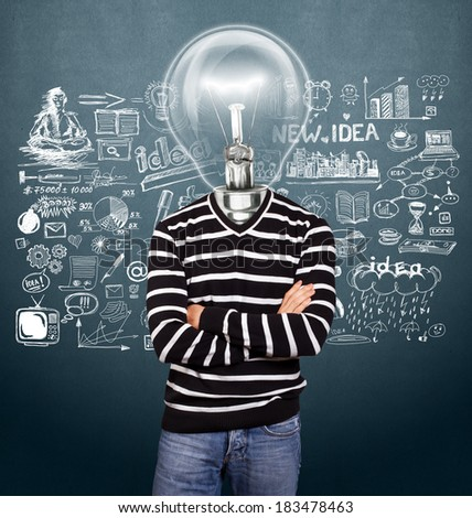 Lamp Head man in striped pullovert, looking on camera, with folded hands - stock photo