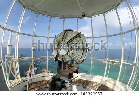 Lamp in the lighthouse room. Large fresnel lens of lighthouse beacon - stock photo