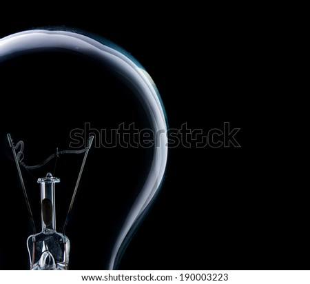 Lamp light bulb isolated on over black background - stock photo