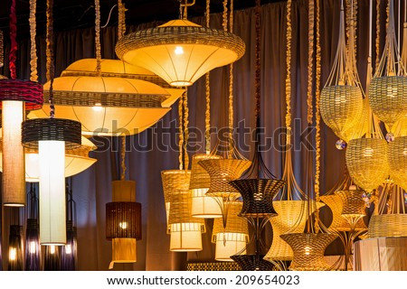 Lamp made ??from a lot of bamboo. Hanging with sales to customers. - stock photo