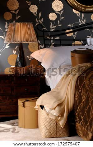 lamp next to the bed - stock photo