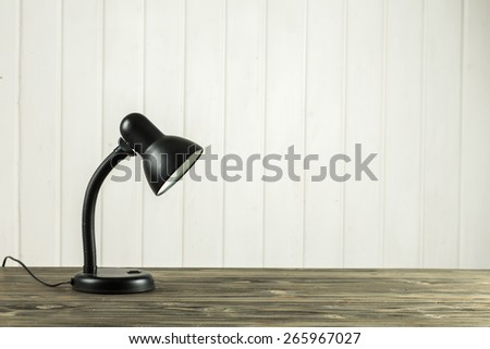 lamp on a wooden table - stock photo
