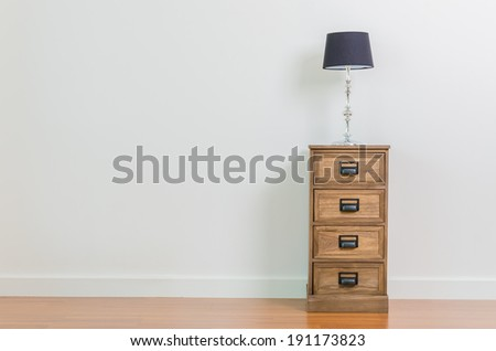 Lamp on bedside table interior room - stock photo