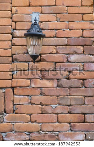 Lamp on the brick wall - stock photo