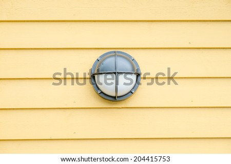 lamp on wooden wall - stock photo