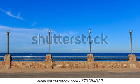 lamp pole in-line in sunshine day blue sky nature background - stock photo
