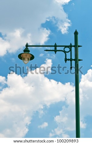 lamp post over blue sky - stock photo