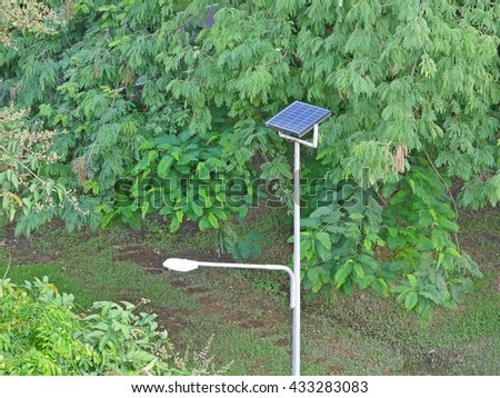 Lamp Post Use Solar Cells in the park - stock photo