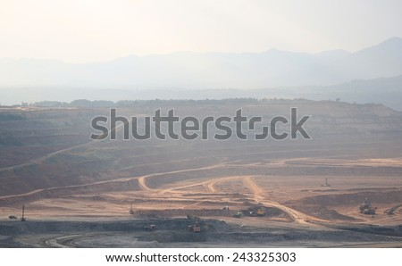 Lampang,Thailand, - December 17,2014 : Excavator at the lignite opencast mining ,Mae Moh Lignite Mine, in northern Thailand, is the largest open-pit lignite mine in Southeast Asia. - stock photo