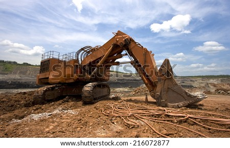 LAMPANG, THAILAND - JUNE 26: coal-preparation plant. track-type loader excavator machine at work site coal transportation, June, 26, 2014 in Lampang, Thailand - stock photo