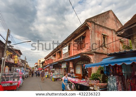 LAMPANG, THAILAND -MAY 28 , 2016 :Kad Kong Ta Street Market .The city center old town building marketing and trading of tourists come to buy souvenirs.Lots of different foods in Lampang, Thailand. - stock photo