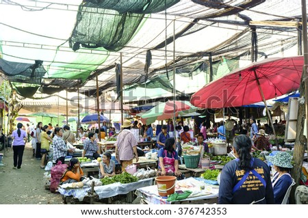 LAMPHUN THAILAND - FEBRUARY 4 : Market villagers walking street, People live in a popular local shopping to cook dinner every day. on Feb. 4, 2016 in Lamphun, Thailand. - stock photo
