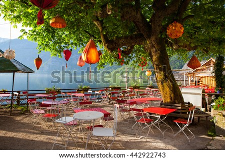 Lampions in empty restaurant of Hallstatt town, Austria - stock photo