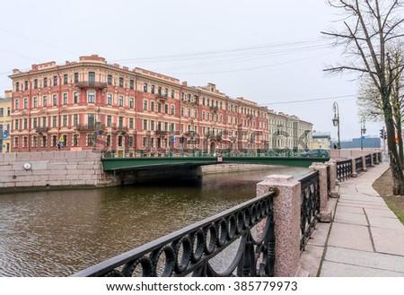Lamppost Bridge and Profitable House MS Voronin in Saint-Petersburg, Russia - stock photo