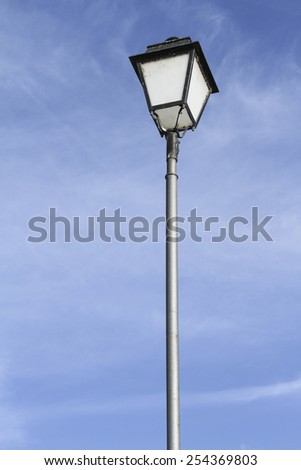 lamppost in blue sky - stock photo