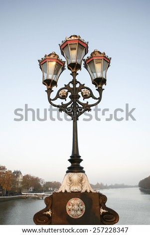 Lamppost  on Putney Bridge, morning,  London