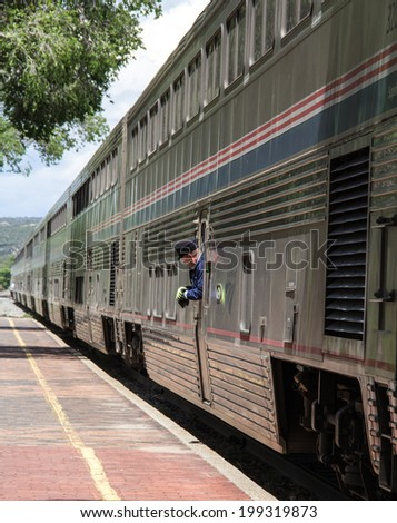 LAMY, NEW MEXICO-JUNE 12: The Southwest Chief pulls into Lamy on June 12, 2014. Amtrak might have to reroute the historic train in the future due to lack of maintenance on the track in New Mexico. - stock photo