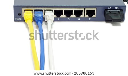 LAN network switch with ethernet cables plugged in isolated on white background.   - stock photo