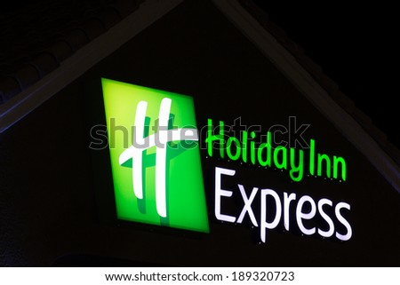 LANCASTER, CA/USA - APRIL 19, 2014: Holiday Inn Express Sign at night. Holiday Inn Express is a mid-priced hotel chain branded by InterContinental Hotels Group. - stock photo