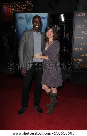 "Lance Reddick and Stephanie Reddick at the ""Phantom"" Premiere, Chinese Theater, Hollywood, CA 02-27-13 - stock photo"