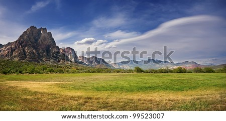 Land and Sky A piece of grass land under a blue sky in Nevada, USA. - stock photo