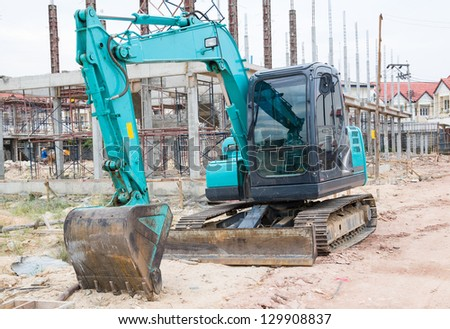 Land excavators green on construction site - stock photo