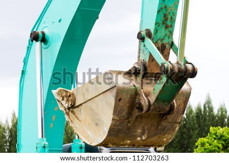 Land excavators green Working on the site - stock photo