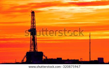 Land Rig during sunset - stock photo