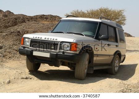 Land Rover Discovery Off Roading 4x4 in Hajar Mountains Dubai UAE - stock photo
