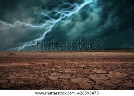 Land to the ground dry cracked. With lightning storm - stock photo