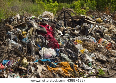 Landfill of waste.Pollution of nature. Pile of domestic garbage.   - stock photo