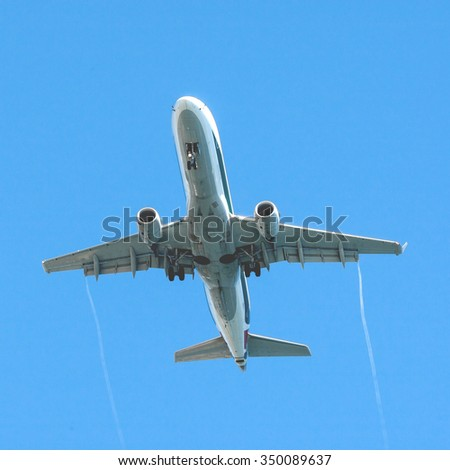 Landing airliner - stock photo