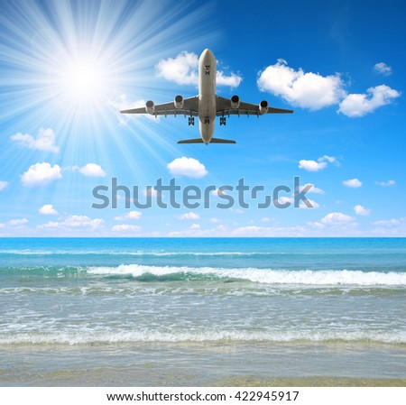 Landing an aircraft on a tropical island. - stock photo