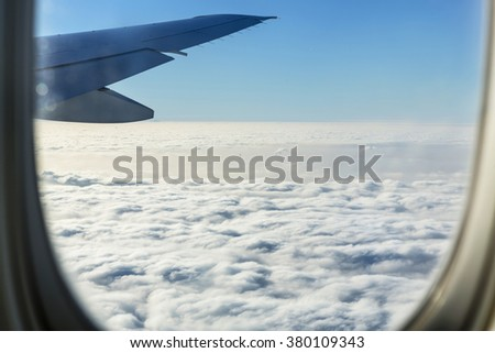 Landing in Paris, amazing view from the window and in the clouds you see silhouette of the Eiffel Tower - stock photo