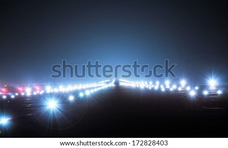 Landing lights at night closeup - stock photo