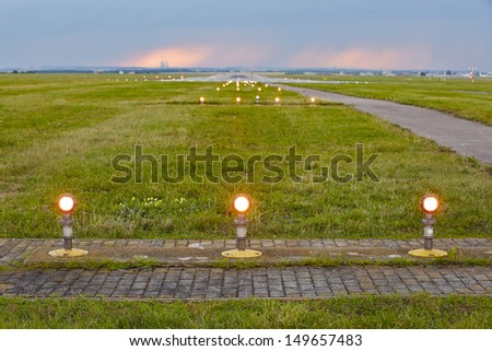 Landing lights - The storm is approaching the airport. - stock photo