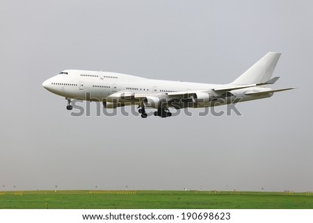Landing of a commercial airliner - stock photo