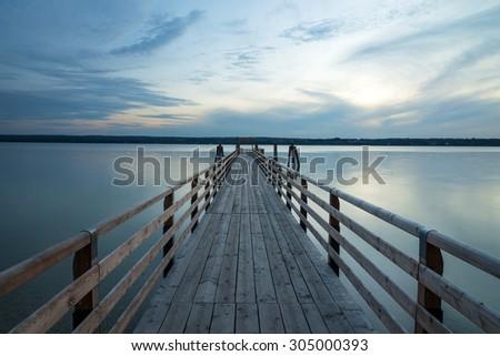 Landing stage at sunset at Lake Ammersee, Breitbrunn, Bavaria, Germany - stock photo