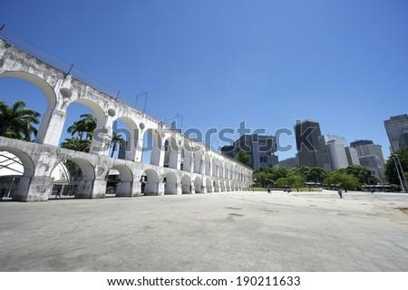 Landmark white arches of Arcos da Lapa at the skyline in Centro of Rio de Janeiro Brazil - stock photo
